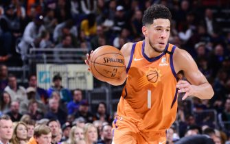 PHOENIX, AZ - JANUARY 3: Devin Booker #1 of the Phoenix Suns handles the ball during the game against the New York Knicks on January 3, 2020 at Talking Stick Resort Arena in Phoenix, Arizona. NOTE TO USER: User expressly acknowledges and agrees that, by downloading and or using this photograph, user is consenting to the terms and conditions of the Getty Images License Agreement. Mandatory Copyright Notice: Copyright 2020 NBAE (Photo by Michael Gonzales/NBAE via Getty Images)