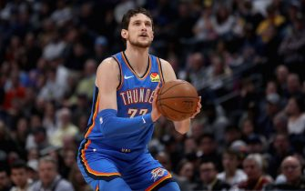 DENVER, COLORADO - DECEMBER 14: Mike Muscala #33 of the Oklahoma City Thunder puts up a shot against the Denver Nuggets in the second quarter at Pepsi Center on December 14, 2019 in Denver, Colorado. NOTE TO USER: User expressly acknowledges and agrees that, by downloading and or using this photograph, User is consenting to the terms and conditions of the Getty Images License Agreement. (Photo by Matthew Stockman/Getty Images)