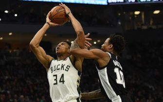 MILWAUKEE, WISCONSIN - JANUARY 04:  Giannis Antetokounmpo #34 of the Milwaukee Bucks is fouled by DeMar DeRozan #10 of the San Antonio Spurs during the second half of a game at Fiserv Forum on January 04, 2020 in Milwaukee, Wisconsin. NOTE TO USER: User expressly acknowledges and agrees that, by downloading and or using this photograph, User is consenting to the terms and conditions of the Getty Images License Agreement. (Photo by Stacy Revere/Getty Images)