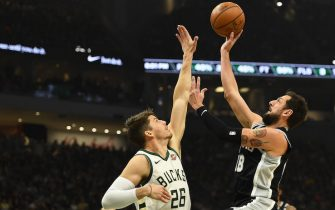 MILWAUKEE, WISCONSIN - JANUARY 04:  Marco Belinelli #18 of the San Antonio Spurs shoots over Kyle Korver #26 of the Milwaukee Bucks during the first half of a game at Fiserv Forum on January 04, 2020 in Milwaukee, Wisconsin. NOTE TO USER: User expressly acknowledges and agrees that, by downloading and or using this photograph, User is consenting to the terms and conditions of the Getty Images License Agreement. (Photo by Stacy Revere/Getty Images)