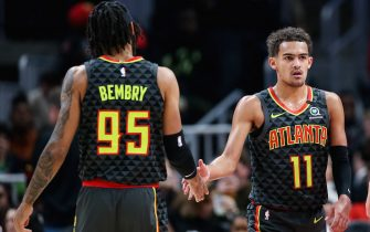 ATLANTA, GA - JANUARY 4: Trae Young #11 slaps hands with DeAndre' Bembry #95 of the Atlanta Hawks during the first quarter of a game against the Indiana Pacers at State Farm Arena on January 4, 2020 in Atlanta, Georgia. NOTE TO USER: User expressly acknowledges and agrees that, by downloading and or using this photograph, User is consenting to the terms and conditions of the Getty Images License Agreement. (Photo by Carmen Mandato/Getty Images)