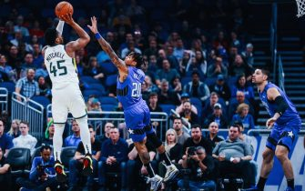 ORLANDO, FLORIDA - JANUARY 04: Markelle Fultz #20 of the Orlando Magic attempts to block a jump shot by Donovan Mitchell #45 of the Utah Jazz in the first quarter at Amway Center on January 04, 2020 in Orlando, Florida. NOTE TO USER: User expressly acknowledges and agrees that, by downloading and/or using this photograph, user is consenting to the terms and conditions of the Getty Images License Agreement. (Photo by Harry Aaron/Getty Images)
