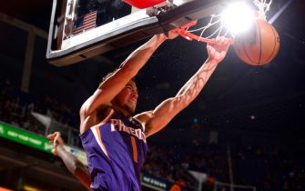 PHOENIX, AZ - JANUARY 5: Devin Booker #1 of the Phoenix Suns dunks the ball during a game against the Memphis Grizzlies on January 5, 2020 at Talking Stick Resort Arena in Phoenix, Arizona. NOTE TO USER: User expressly acknowledges and agrees that, by downloading and or using this photograph, user is consenting to the terms and conditions of the Getty Images License Agreement. Mandatory Copyright Notice: Copyright 2020 NBAE (Photo by Barry Gossage/NBAE via Getty Images)