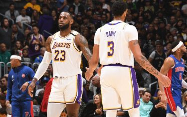 LOS ANGELES, CA - JANUARY 5: LeBron James #23 and Anthony Davis #3 of the Los Angeles Lakers hi-five during the game against the Detroit Pistons  on January 5, 2020 at STAPLES Center in Los Angeles, California. NOTE TO USER: User expressly acknowledges and agrees that, by downloading and/or using this Photograph, user is consenting to the terms and conditions of the Getty Images License Agreement. Mandatory Copyright Notice: Copyright 2020 NBAE (Photo by Andrew D. Bernstein/NBAE via Getty Images)
