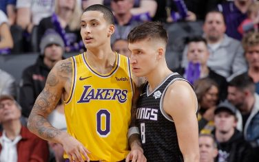 SACRAMENTO, CA - DECEMBER 27: Kyle Kuzma #0 of the Los Angeles Lakers faces off against Bogdan Bogdanovic #8 of the Sacramento Kings on December 27, 2018 at Golden 1 Center in Sacramento, California. NOTE TO USER: User expressly acknowledges and agrees that, by downloading and or using this photograph, User is consenting to the terms and conditions of the Getty Images Agreement. Mandatory Copyright Notice: Copyright 2018 NBAE (Photo by Rocky Widner/NBAE via Getty Images)