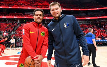 ATLANTA, GA - OCTOBER 24: Trae Young #11 of the Atlanta Hawks and Luka Doncic #77 of the Dallas Mavericks pose for a photo before the game on October 24, 2018 at State Farm Arena in Atlanta, Georgia. NOTE TO USER: User expressly acknowledges and agrees that, by downloading and/or using this photograph, user is consenting to the terms and conditions of the Getty Images License Agreement. Mandatory Copyright Notice: Copyright 2018 NBAE (Photo by Scott Cunningham/NBAE via Getty Images)