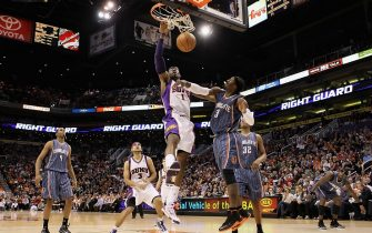 PHOENIX - JANUARY 26:  Amar'e Stoudemire #1 of the Phoenix Suns slam dunks the ball over Gerald Wallace #3 of the Charlotte Bobcats during the NBA game at US Airways Center on January 26, 2010 in Phoenix, Arizona. The Bobcats defeated the Suns in overtime 114-109.  NOTE TO USER: User expressly acknowledges and agrees that, by downloading and or using this photograph, User is consenting to the terms and conditions of the Getty Images License Agreement.  (Photo by Christian Petersen/Getty Images)