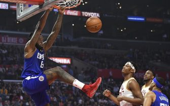 LOS ANGELES, CA - APRIL 01: DeAndre Jordan #6 of the Los Angeles Clippers dunks the ball while Myles Turner #33 of the Indiana Pacers looks on in the first half at Staples Center on April 1, 2018 in Los Angeles, California. NOTE TO USER: User expressly acknowledges and agrees that, by downloading and or using this photograph, User is consenting to the terms and conditions of the Getty Images License Agreement. (Photo by John McCoy/Getty Images)