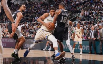 SAN ANTONIO, TX - JANUARY 6: Giannis Antetokounmpo #34 of the Milwaukee Bucks handles the ball against the San Antonio Spurs on January 6, 2020 at the AT&T Center in San Antonio, Texas. NOTE TO USER: User expressly acknowledges and agrees that, by downloading and or using this photograph, user is consenting to the terms and conditions of the Getty Images License Agreement. Mandatory Copyright Notice: Copyright 2020 NBAE (Photos by Darren Carroll/NBAE via Getty Images)