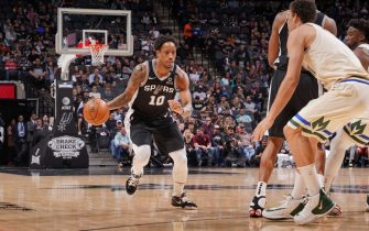 SAN ANTONIO, TX - JANUARY 6: DeMar DeRozan #10 of the San Antonio Spurs handles the ball against the Milwaukee Bucks on January 6, 2020 at the AT&T Center in San Antonio, Texas. NOTE TO USER: User expressly acknowledges and agrees that, by downloading and or using this photograph, user is consenting to the terms and conditions of the Getty Images License Agreement. Mandatory Copyright Notice: Copyright 2020 NBAE (Photos by Darren Carroll/NBAE via Getty Images)