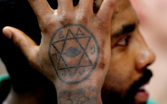 MIAMI, FL - JANUARY 10:  A detail of Kyrie Irving #11 of the Boston Celtics tattoo against the Miami Heat during the second half at American Airlines Arena on January 10, 2019 in Miami, Florida. NOTE TO USER: User expressly acknowledges and agrees that, by downloading and or using this photograph, User is consenting to the terms and conditions of the Getty Images License Agreement.  (Photo by Michael Reaves/Getty Images)