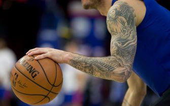 PHILADELPHIA, PA - NOVEMBER 20: The tattooed left arm of JJ Redick #17 of the Philadelphia 76ers dribbles the ball during warm ups prior to the game against the Utah Jazz at the Wells Fargo Center on November 20, 2017 in Philadelphia, Pennsylvania. NOTE TO USER: User expressly acknowledges and agrees that, by downloading and or using this photograph, User is consenting to the terms and conditions of the Getty Images License Agreement. (Photo by Mitchell Leff/Getty Images)