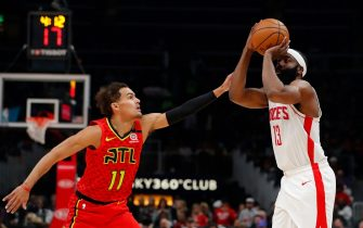 ATLANTA, GEORGIA - JANUARY 08:  James Harden #13 of the Houston Rockets shoots a three-point basket against Trae Young #11 of the Atlanta Hawks in the first half at State Farm Arena on January 08, 2020 in Atlanta, Georgia.  NOTE TO USER: User expressly acknowledges and agrees that, by downloading and/or using this photograph, user is consenting to the terms and conditions of the Getty Images License Agreement.  (Photo by Kevin C. Cox/Getty Images)