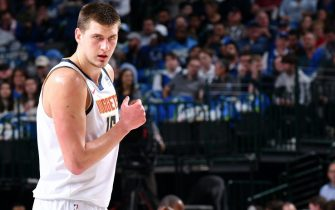 DALLAS, TX - JANUARY 8: Nikola Jokic #15 of the Denver Nuggets looks on during the game against the Dallas Mavericks on January 8, 2020 at the American Airlines Center in Dallas, Texas. NOTE TO USER: User expressly acknowledges and agrees that, by downloading and or using this photograph, User is consenting to the terms and conditions of the Getty Images License Agreement. Mandatory Copyright Notice: Copyright 2020 NBAE (Photo by Glenn James/NBAE via Getty Images)