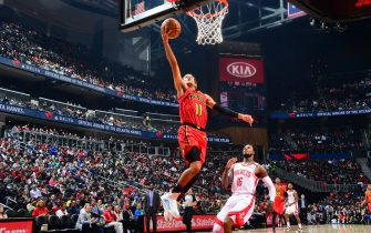 ATLANTA, GA - JANUARY 8: Trae Young #11 of the Atlanta Hawks shoots the ball against the Houston Rockets on January 8, 2020 at State Farm Arena in Atlanta, Georgia.  NOTE TO USER: User expressly acknowledges and agrees that, by downloading and/or using this Photograph, user is consenting to the terms and conditions of the Getty Images License Agreement. Mandatory Copyright Notice: Copyright 2020 NBAE (Photo by Scott Cunningham/NBAE via Getty Images)