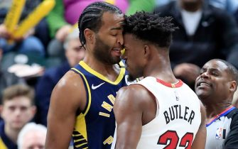 INDIANAPOLIS, INDIANA - JANUARY 08:  Jimmy Butler #22 of the Miami Heat and T.J. Warren #1 of  the Indiana Pacers get involved in an argument during the game at Bankers Life Fieldhouse on January 08, 2020 in Indianapolis, Indiana.    NOTE TO USER: User expressly acknowledges and agrees that, by downloading and or using this photograph, User is consenting to the terms and conditions of the Getty Images License Agreement. (Photo by Andy Lyons/Getty Images)