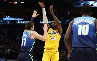 DALLAS, TEXAS - JANUARY 10:   LeBron James #23 of the Los Angeles Lakers takes a shot against Luka Doncic #77 of the Dallas Mavericks at American Airlines Center on January 10, 2020 in Dallas, Texas.  NOTE TO USER: User expressly acknowledges and agrees that, by downloading and or using this photograph, User is consenting to the terms and conditions of the Getty Images License Agreement.  (Photo by Ronald Martinez/Getty Images)