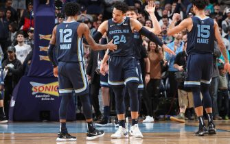 MEMPHIS, TN - JANUARY 10: Ja Morant #12 of the Memphis Grizzlies high-fives Dillon Brooks #24 of the Memphis Grizzlies against the San Antonio Spurs on January 10, 2020 at FedExForum in Memphis, Tennessee. NOTE TO USER: User expressly acknowledges and agrees that, by downloading and or using this photograph, User is consenting to the terms and conditions of the Getty Images License Agreement. Mandatory Copyright Notice: Copyright 2020 NBAE (Photo by Joe Murphy/NBAE via Getty Images)