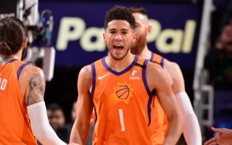PHOENIX, AZ - JANUARY 10: Devin Booker #1 of the Phoenix Suns reacts to play against the Orlando Magic on January 10, 2020 at Talking Stick Resort Arena in Phoenix, Arizona. NOTE TO USER: User expressly acknowledges and agrees that, by downloading and or using this photograph, user is consenting to the terms and conditions of the Getty Images License Agreement. Mandatory Copyright Notice: Copyright 2020 NBAE (Photo by Barry Gossage/NBAE via Getty Images)