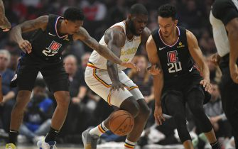 LOS ANGELES, CA - JANUARY 10: Lou Williams #23, Eric Paschall #7 and Landry Shamet #20 of the LA Clippers sramble for the ball in the first half of the Golden State Warriors  at Staples Center on January 10, 2020 in Los Angeles, California. NOTE TO USER: User expressly acknowledges and agrees that, by downloading and/or using this photograph, user is consenting to the terms and conditions of the Getty Images License Agreement. (Photo by John McCoy/Getty Images)