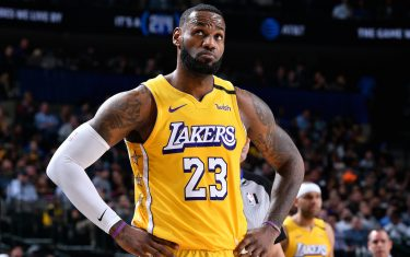 DALLAS, TX - JANUARY 10: LeBron James #23 of the Los Angeles Lakers looks on during the game against the Dallas Mavericks on January 10, 2020 at the American Airlines Center in Dallas, Texas. NOTE TO USER: User expressly acknowledges and agrees that, by downloading and or using this photograph, User is consenting to the terms and conditions of the Getty Images License Agreement. Mandatory Copyright Notice: Copyright 2020 NBAE (Photo by Glenn James/NBAE via Getty Images)