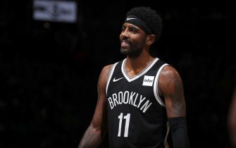 BROOKLYN, NY - October 25: Kyrie Irving #11 of the Brooklyn Nets smiles during game against the New York Knicks on October 25, 2019 at Barclays Center in Brooklyn, New York. NOTE TO USER: User expressly acknowledges and agrees that, by downloading and or using this Photograph, user is consenting to the terms and conditions of the Getty Images License Agreement. Mandatory Copyright Notice: Copyright 2019 NBAE (Photo by Nathaniel S. Butler/NBAE via Getty Images)