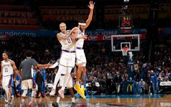 OKLAHOMA CITY, OK - JANUARY 11: JaVale McGee #7 of the Los Angeles Lakers and Kyle Kuzma #0 of the Los Angeles Lakers reacts to play against the Oklahoma City Thunder on January 11, 2020 at Chesapeake Energy Arena in Oklahoma City, Oklahoma. NOTE TO USER: User expressly acknowledges and agrees that, by downloading and or using this photograph, User is consenting to the terms and conditions of the Getty Images License Agreement. Mandatory Copyright Notice: Copyright 2020 NBAE (Photo by Jeff Haynes/NBAE via Getty Images)