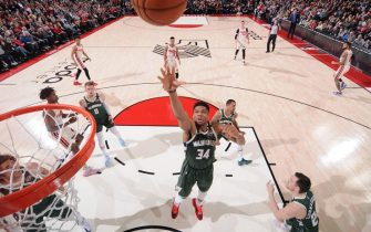 PORTLAND, OR - JANUARY 11: Giannis Antetokounmpo #34 of the Milwaukee Bucks grabs the rebound against the Portland Trail Blazers on January 11, 2020 at the Moda Center Arena in Portland, Oregon. NOTE TO USER: User expressly acknowledges and agrees that, by downloading and or using this photograph, user is consenting to the terms and conditions of the Getty Images License Agreement. Mandatory Copyright Notice: Copyright 2020 NBAE (Photo by Sam Forencich/NBAE via Getty Images)