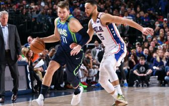 DALLAS, TX - JANUARY 11: Luka Doncic #77 of the Dallas Mavericks handles the ball while Ben Simmons #25 of the Philadelphia 76ers plays defense during the game on January 11, 2020 at the American Airlines Center in Dallas, Texas. NOTE TO USER: User expressly acknowledges and agrees that, by downloading and or using this photograph, User is consenting to the terms and conditions of the Getty Images License Agreement. Mandatory Copyright Notice: Copyright 2020 NBAE (Photo by Glenn James/NBAE via Getty Images)