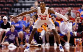 SUNRISE, FLORIDA - DECEMBER 21:  Scottie Lewis #23 of the Florida Gators defends against the Utah State Aggies during the second half of the Orange Bowl Basketball Classic at BB&T Center on December 21, 2019 in Sunrise, Florida. (Photo by Michael Reaves/Getty Images)