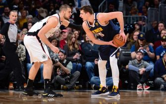 DENVER, CO - JANUARY 12: Nikola Jokic #15 of the Denver Nuggets handles the ball during the game against the LA Clippers on January 12, 2020 at the Pepsi Center in Denver, Colorado. NOTE TO USER: User expressly acknowledges and agrees that, by downloading and/or using this Photograph, user is consenting to the terms and conditions of the Getty Images License Agreement. Mandatory Copyright Notice: Copyright 2020 NBAE (Photo by Bart Young/NBAE via Getty Images)