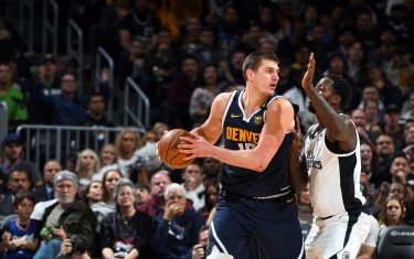 DENVER, CO - JANUARY 12: Nikola Jokic #15 of the Denver Nuggets handles the ball during the game against the LA Clippers on January 12, 2020 at the Pepsi Center in Denver, Colorado. NOTE TO USER: User expressly acknowledges and agrees that, by downloading and/or using this Photograph, user is consenting to the terms and conditions of the Getty Images License Agreement. Mandatory Copyright Notice: Copyright 2020 NBAE (Photo by Garrett Ellwood/NBAE via Getty Images)