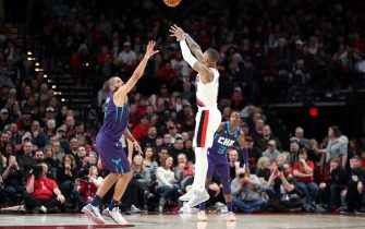 PORTLAND, OREGON - JANUARY 13: Damian Lillard #0 of the Portland Trail Blazers takes a shot against Nicolas Batum #5 of the Charlotte Hornets in the fourth quarter  at Moda Center on January 13, 2020 in Portland, Oregon. (Photo by Abbie Parr/Getty Images)