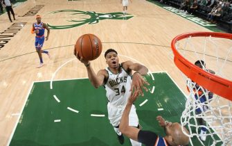 MILWAUKEE, WI - JANUARY 14: Giannis Antetokounmpo #34 of the Milwaukee Bucks shoots the ball against the New York Knicks on January 14, 2020 at the Fiserv Forum Center in Milwaukee, Wisconsin. NOTE TO USER: User expressly acknowledges and agrees that, by downloading and or using this Photograph, user is consenting to the terms and conditions of the Getty Images License Agreement. Mandatory Copyright Notice: Copyright 2020 NBAE (Photo by Gary Dineen/NBAE via Getty Images).