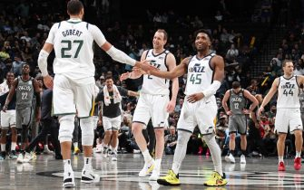 BROOKLYN, NY - JANUARY 14: Rudy Gobert #27 of the Utah Jazz high-fives Joe Ingles #2 of the Utah Jazz and Donovan Mitchell #45 of the Utah Jazz during the game against the Brooklyn Nets on January 14, 2020 at Barclays Center in Brooklyn, New York. NOTE TO USER: User expressly acknowledges and agrees that, by downloading and or using this Photograph, user is consenting to the terms and conditions of the Getty Images License Agreement. Mandatory Copyright Notice: Copyright 2020 NBAE (Photo by Nathaniel S. Butler/NBAE via Getty Images)