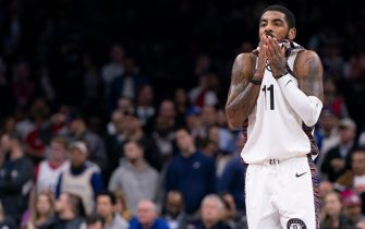 PHILADELPHIA, PA - JANUARY 15: Kyrie Irving #11 of the Brooklyn Nets wipes his face against the Philadelphia 76ers in the fourth quarter at the Wells Fargo Center on January 15, 2020 in Philadelphia, Pennsylvania. The 76ers defeated the Nets 117-106. NOTE TO USER: User expressly acknowledges and agrees that, by downloading and/or using this photograph, user is consenting to the terms and conditions of the Getty Images License Agreement. (Photo by Mitchell Leff/Getty Images)
