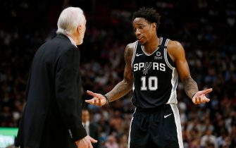 MIAMI, FLORIDA - JANUARY 15:  DeMar DeRozan #10 of the San Antonio Spurs reacts while talking with head coach Gregg Popovich against the Miami Heat during the second half at American Airlines Arena on January 15, 2020 in Miami, Florida. NOTE TO USER: User expressly acknowledges and agrees that, by downloading and/or using this photograph, user is consenting to the terms and conditions of the Getty Images License Agreement. (Photo by Michael Reaves/Getty Images)
