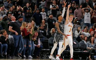 SAN ANTONIO, TX - JANUARY 17:  Kevin Huerter #3  of the Atlanta Hawks celebrates his game winning three next to Dejounte Murray #5 of the San Antonio Spurs during second half action at AT&T Center on January 17, 2020 in San Antonio, Texas.  Atlanta Hawks defeated the San Antonio Spurs 121-120. NOTE TO USER: User expressly acknowledges and agrees that ,by downloading and or using this photograph, User is consenting to the terms and conditions of the Getty Images License Agreement. (Photo by Ronald Cortes/Getty Images)