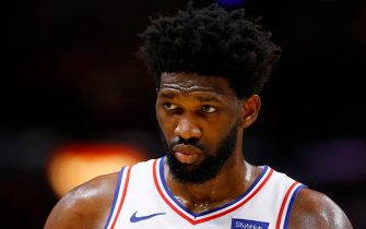 MIAMI, FLORIDA - DECEMBER 28:  Joel Embiid #21 of the Philadelphia 76ers reacts against the Miami Heat during the first half at American Airlines Arena on December 28, 2019 in Miami, Florida. NOTE TO USER: User expressly acknowledges and agrees that, by downloading and/or using this photograph, user is consenting to the terms and conditions of the Getty Images License Agreement. (Photo by Michael Reaves/Getty Images)
