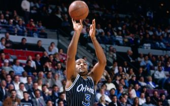 AUBURN HILLS, MI - 1996: Dennis Scott #3 of the Orlando Magic shoots  circa 1996 at the Palace of Auburn Hills in Auburn Hills, Michigan. NOTE TO USER: User expressly acknowledges and agrees that, by downloading and or using this photograph, User is consenting to the terms and conditions of the Getty Images License Agreement. Mandatory Copyright Notice: Copyright 1996 NBAE (Photo by Steve Woltmann/NBAE via Getty Images)