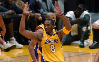 LOS ANGELES - JANUARY 7:  Kobe Bryant #8 of the Los Angeles Lakers gestures after scoring one of his twelve three pointers during the NBA game against the Seattle Sonics at Staples Center on January 7, 2003 in Los Angeles, California. Bryant scored 45 points and set NBA records with nine consecutive 3-pointers and 12 overall as the Los Angeles Lakers defeated the Seattle SuperSonics 119-98.  NOTE TO USER: User expressly acknowledges and agrees that, by downloading and/or using this Photograph, User is consenting to the terms and conditions of the Getty Images License Agreement.  Mandatory copyright notice: Copyright 2003 NBAE.  (Photo by Noah Graham/NBAE via Getty Images)