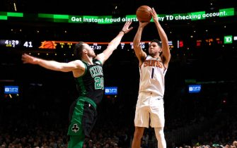 BOSTON, MA - JANUARY 18: Devin Booker #1 of the Phoenix Suns shoots the ball during a game against the Boston Celtics on January 18, 2020 at the TD Garden in Boston, Massachusetts.  NOTE TO USER: User expressly acknowledges and agrees that, by downloading and or using this photograph, User is consenting to the terms and conditions of the Getty Images License Agreement. Mandatory Copyright Notice: Copyright 2020 NBAE  (Photo by Brian Babineau/NBAE via Getty Images)