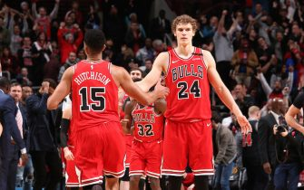 CHICAGO, IL - JANUARY 18: Lauri Markkanen #24 of the Chicago Bulls high fives Chandler Hutchison #15 of the Chicago Bulls during a game against the Cleveland Cavaliers on January 18, 2020 at the United Center in Chicago, Illinois. NOTE TO USER: User expressly acknowledges and agrees that, by downloading and or using this photograph, user is consenting to the terms and conditions of the Getty Images License Agreement.  Mandatory Copyright Notice: Copyright 2020 NBAE (Photo by Gary Dineen/NBAE via Getty Images)