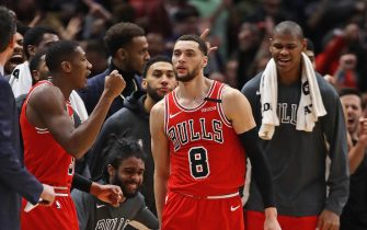 CHICAGO, ILLINOIS - JANUARY 18: Members of the Chicago Bulls react after Zach LaVine #8 scored the game-winning basket in the final seconds on his way to a game-high 42 points against the Cleveland Cavaliers at the United Center on January 18, 2020 in Chicago, Illinois. The Bulls defeated the Cavaliers 118-116. NOTE TO USER: User expressly acknowledges and agrees that, by downloading and or using this photograph, User is consenting to the terms and conditions of the Getty Images License Agreement. (Photo by Jonathan Daniel/Getty Images)