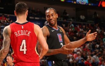 NEW ORLEANS, LA - JANUARY 18: JJ Redick #4 of the New Orleans Pelicans talks with Kawhi Leonard #2 of the LA Clippers during the game on January 18, 2020 at the Smoothie King Center in New Orleans, Louisiana. NOTE TO USER: User expressly acknowledges and agrees that, by downloading and or using this Photograph, user is consenting to the terms and conditions of the Getty Images License Agreement. Mandatory Copyright Notice: Copyright 2020 NBAE (Photo by Layne Murdoch Jr./NBAE via Getty Images)