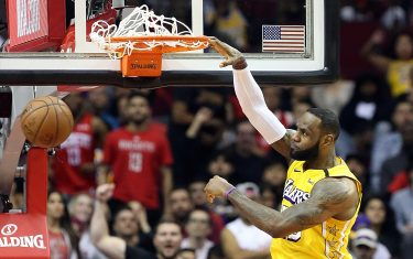 HOUSTON, TEXAS - JANUARY 18: LeBron James #23 of the Los Angeles Lakers dunks on a fast break against the Houston Rockets during the first quarter at Toyota Center on January 18, 2020 in Houston, Texas.  NOTE TO USER: User expressly acknowledges and agrees that, by downloading and/or using this photograph, user is consenting to the terms and conditions of the Getty Images License Agreement.  (Photo by Bob Levey/Getty Images)