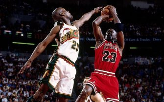 SEATTLE - JUNE 9:  Michael Jordan #23 of the Chicago Buls shoots a jump shot over Gary Payton #20 of the Seattle SuperSonics during game three of the 1996 NBA Finals played June 9, 1996 at the Key Arena in Seattle, Washington.  NOTE TO USER: User expressly acknowledges that, by downloading and or using this photograph, User is consenting to the terms and conditions of the Getty Images License agreement. Mandatory Copyright Notice: Copyright 1996 NBAE (Photo by Andrew D. Bernstein/NBAE via Getty Images)