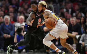 LOS ANGELES, CA - JANUARY 10: Patrick Beverley #21 of the LA Clippers guards Ky Bowman #12 of the Golden State Warriors in the second half at Staples Center on January 10, 2020 in Los Angeles, California. NOTE TO USER: User expressly acknowledges and agrees that, by downloading and/or using this photograph, user is consenting to the terms and conditions of the Getty Images License Agreement. (Photo by John McCoy/Getty Images)