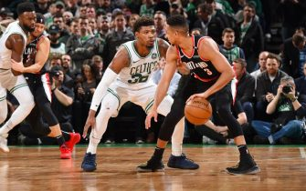 BOSTON, MA - FEBRUARY 27: Marcus Smart #36 of the Boston Celtics plays defense against CJ McCollum #3 of the Portland Trail Blazers on February 27, 2019 at the TD Garden in Boston, Massachusetts.  NOTE TO USER: User expressly acknowledges and agrees that, by downloading and or using this photograph, User is consenting to the terms and conditions of the Getty Images License Agreement. Mandatory Copyright Notice: Copyright 2019 NBAE  (Photo by Brian Babineau/NBAE via Getty Images)