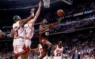 CHICAGO - JUNE 5:  Gary Payton #20 of the Seattle SuperSonics attempts a layup against Dennis Rodman #91 of the Chicago Bulls during Game One of the NBA Finals at the United Center on June 5, 1996 in Chicago, Illinois.  The Bulls won 107-90.  NOTE TO USER: User expressly acknowledges that, by downloading and or using this photograph, User is consenting to the terms and conditions of the Getty Images License agreement. Mandatory Copyright Notice: Copyright 1996 NBAE (Photo by Andy Hayt/NBAE via Getty Images)